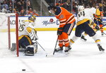 Nashville Predators goalie Pekka Rinne (35) makes the save as Edmonton Oilers' James Neal (18) tries to screen during second period NHL hockey action in Edmonton, Alberta, Tuesday, Jan. 14, 2019. (Jason Franson/The Canadian Press via AP)