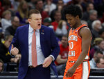 Illinois head coach Brad Underwood talks to guard Andres Feliz during the first half of an NCAA college basketball game in the first round of the Big Ten Conference tournament against Northwestern in Chicago, Wednesday, March 13, 2019. (AP Photo/Nam Y. Huh)
