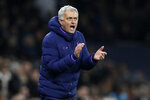 FILE - Tottenham's manager Jose Mourinho applauds during the last minutes of the English FA Cup fourth round replay soccer match between Tottenham Hotspur and Southampton at the Tottenham Hotspur Stadium in London. José Mourinho has been hired to coach Italian club Roma starting next season. The move came a few hours after the club's American owners announced that current coach Paulo Fonseca will depart at the end of this season. Mourinho's contract is for three seasons. Mourinho previously coached in Serie A at Inter Milan. (AP Photo/Kirsty Wigglesworth, File)