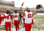 Utah offensive lineman Paul Toala (65) and teammates celebrate after an NCAA college football game against Colorado, Saturday, Nov. 17, 2018, in Boulder, Colo. Utah won 30-7. (AP Photo/David Zalubowski)