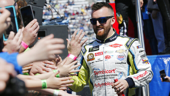 Monster Energy NASCAR Cup Series driver Austin Dillon (3) greets fans during driver introductions prior to the NASCAR Cup Series auto race at the Martinsville Speedway in Martinsville, Va., Sunday, March 24, 2019. (AP Photo/Steve Helber)