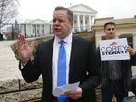 FILE - In this Feb. 22, 2018 file photo, Virginia GOP senatorial hopeful, Corey Stewart, gestures during a news conference at the Capitol in Richmond, Va. Stewart, a conservative provocateur and supporter of President Donald Trump won Virginia's Republican primary Tuesday, June 12, 2018, in the U.S. Senate race, and he has promised to run a