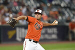 Baltimore Orioles pitcher John Means throws against the Tampa Bay Rays in the first inning of baseball game, Saturday, Aug. 28, 2021, in Baltimore. (AP Photo/Gail Burton)