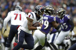 Houston Texans quarterback Deshaun Watson runs with the ball against the Baltimore Ravens prior to an NFL football game, Sunday, Nov. 17, 2019, in Baltimore. (AP Photo/Gail Burton)
