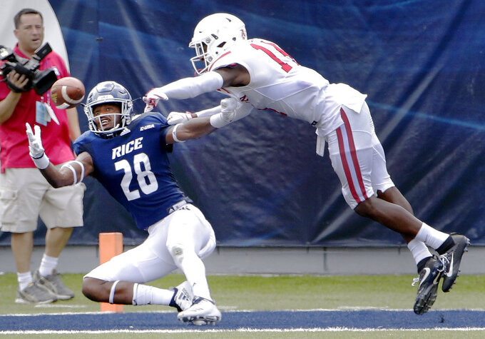 Rice wide receiver Aaron Cephus (28) drops the pass in the end zone on the penalty by Houston cornerback Isaiah Johnson (14) during the first half of a NCAA college football game Saturday, Sep. 1, 2018, in Houston. (AP Photo/Michael Wyke)