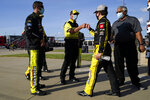 Brandon Jones, second from right, is congratulated after winning a NASCAR Xfinity Series auto race at Kansas Speedway in Kansas City, Kan., Saturday, July 25, 2020. (AP Photo/Charlie Riedel)