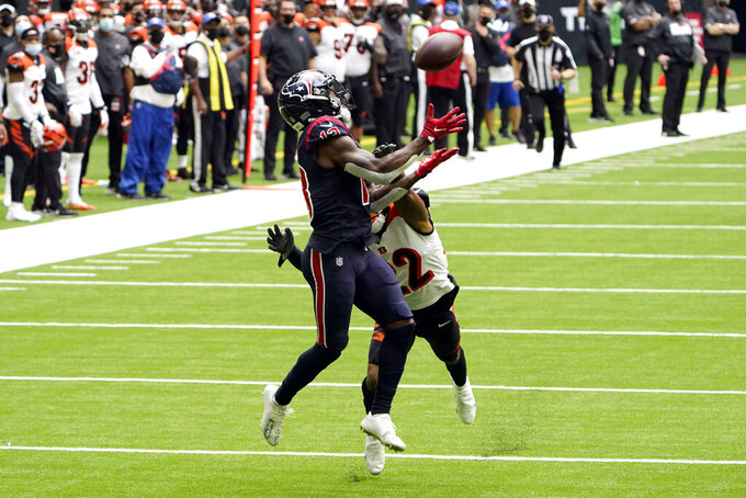 Houston Texans wide receiver Brandin Cooks (13) catches a pass for a first down as Cincinnati Bengals cornerback William Jackson III (22) defends during the first half of an NFL football game Sunday, Dec. 27, 2020, in Houston. (AP Photo/Eric Christian Smith)