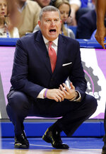 FILE  - In this Nov. 20, 2016, file photo, then-Duquesne head coach Jim Ferry shouts instructions to his team during the first half of an NCAA college basketball game against Kentucky, in Lexington, Ky. The momentum Penn State appeared to be building during the 2019-20 season has come to a screeching halt. The Nittany Lions enter 2020-21 still reeling from head coach Pat Chambers' abrupt departure last month. It's up to interim coach Jim Ferry to pick up the pieces. (AP Photo/James Crisp, File)