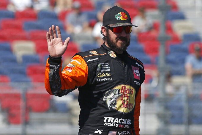 Martin Truex Jr. during driver introductions prior to the NASCAR Cup Series auto race at ISM Raceway, Sunday, Nov. 10, 2019, in Avondale, Ariz. (AP Photo/Ralph Freso)