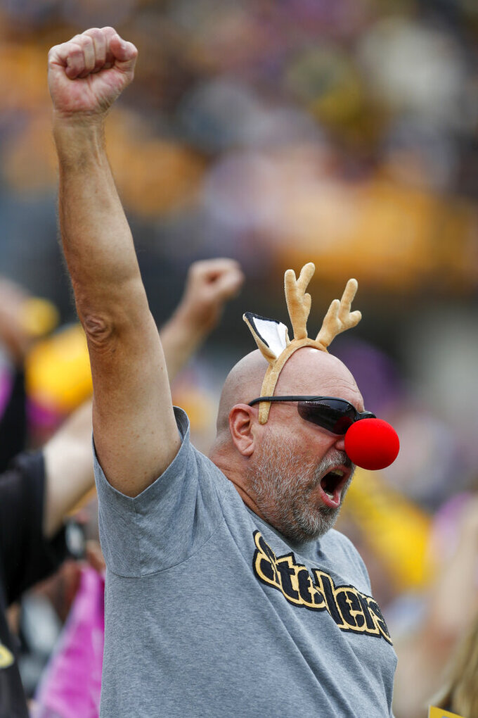 A fan wears a red nose and antlers as he cheers Pittsburgh Steelers quarterback Mason Rudolph before an NFL football game against the Baltimore Ravens, Sunday, Oct. 6, 2019, in Pittsburgh. (AP Photo/Don Wright)