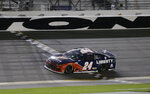 William Byron crosses the finish line to win the NASCAR Cup Series auto race at Daytona International Speedway, Saturday, Aug. 29, 2020, in Daytona Beach, Fla. (AP Photo/Terry Renna)