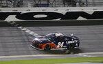 William Byron crosses the finish line to win the NASCAR Cup Series auto race at Daytona International Speedway, Saturday, Aug. 29, 2020, in Daytona Beach, Fla. (AP Photo/Terry Renna)