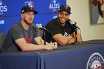 Minnesota Twins designated hitter Nelson Cruz, right, enjoys a laugh as catcher Mitch Garver answers a question from the media Tuesday, Oct. 1, 2019, in Minneapolis as the Twins prepare for the American League Division Series baseball playoffs. The Twins and Yankees play Game 1 of a best-of-five series on Friday in New York. (AP Photo/Jim Mone)