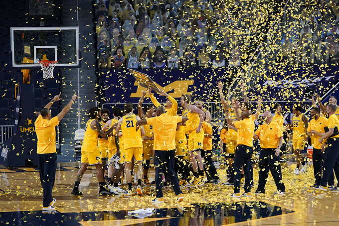 Michigan celebrates after winning the Big Ten title with a victory over Michigan State in an NCAA college basketball game Thursday, March 4, 2021, in Ann Arbor, Mich. (AP Photo/Carlos Osorio)