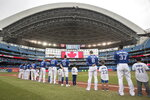 Toronto Blue Jays players line up with Junior Jays for the singing of the national anthems prior to a baseball game against the Tampa Bay Rays in Toronto, Sunday, Sept. 29, 2019. (Fred Thornhill/The Canadian Press via AP)
