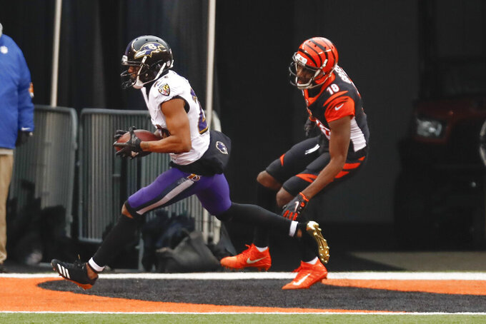 Baltimore Ravens cornerback Marcus Peters (24) intercepts a pass in the end zone intended for Cincinnati Bengals wide receiver A.J. Green (18) during the second half of an NFL football game, Sunday, Jan. 3, 2021, in Cincinnati. (AP Photo/Aaron Doster)