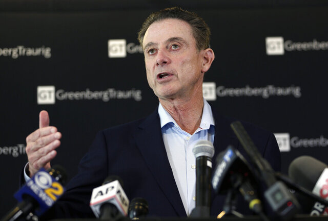 FILE - In this Feb. 21, 2018, file photo, former Louisville basketball coach Rick Pitino appears during a news conference in New York. Hall of Famer Pitino was named basketball coach at Iona College on Saturday, March 14, 2020. Pitino coached at Louisville from 2001-17 before being fired in a pay-for-play scandal and had been coaching in Greece. He replaces Tim Cluess, who resigned Friday after 10 years and six NCAA Tournament appearances due to health concerns. (AP Photo/Seth Wenig, File)