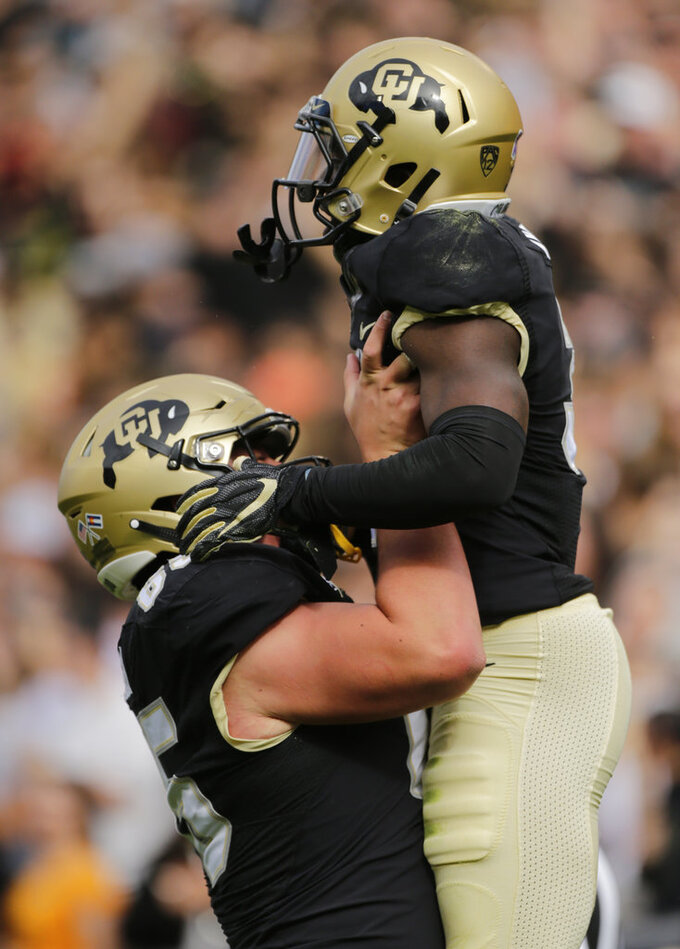 Colorado wide receiver K.D. Nixon (3) celebrates a touchdown with offensive lineman Colby Pursell (65) during the first half of an NCAA college football game against Oregon State, Saturday, Oct. 27, 2018, in Boulder, Colo. (AP Photo/Jack Dempsey)