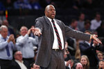 Georgetown head coach Patrick Ewing encourages the crowd to get behind his team during the second half of the first round of the 2K Empire Classic NCAA college basketball tournament, Thursday, Nov. 21, 2019, in New York. Georgetown defeated Texas 82-66. (AP Photo/Kathy Willens)