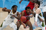 Houston forward Justin Gorham, center, loses the ball between Baylor guard Davion Mitchell (45) and guard Matthew Mayer, right, during the first half of a men's Final Four NCAA college basketball tournament semifinal game, Saturday, April 3, 2021, at Lucas Oil Stadium in Indianapolis. (AP Photo/Michael Conroy)
