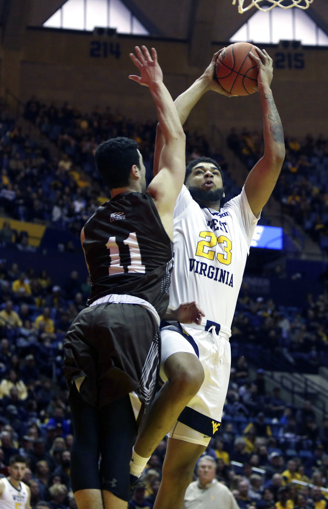 West Virginia forward Esa Ahmad (23) drives to the basket while defended by Lehigh guard Jordan Cohen (11) during the second half of an NCAA college basketball game Sunday, Dec. 30, 2018, in Morgantown, W.Va. (AP Photo/Raymond Thompson)