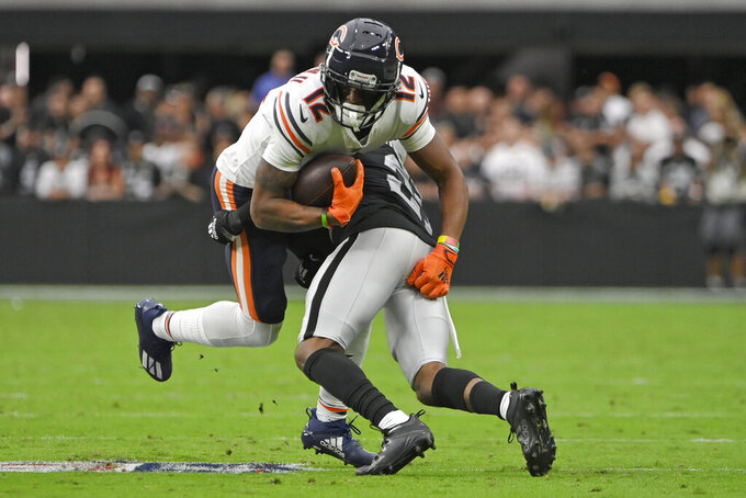 Las Vegas Raiders cornerback Amik Robertson (21) tackles Chicago Bears wide receiver Allen Robinson (12) after Robinson made a catch during the first half of an NFL football game, Sunday, Oct. 10, 2021, in Las Vegas. (AP Photo/David Becker)