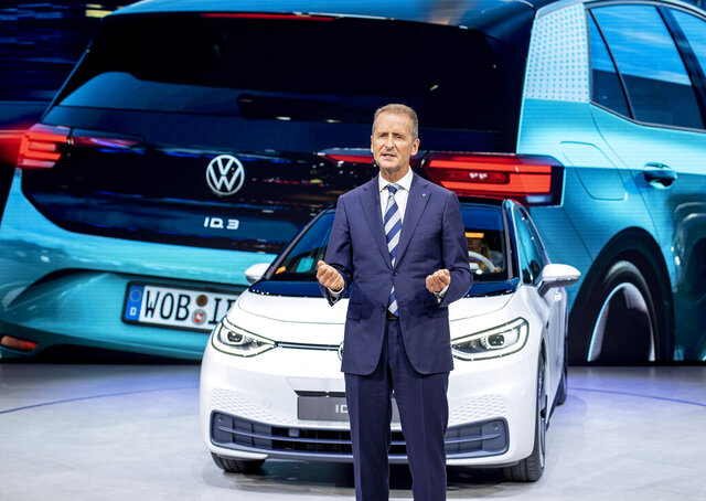 FILE - In this file photo dated Monday, Sept. 9, 2019, CEO of Volkswagen Herbert Diess introduces the new VW ID.3 at the IAA Auto Show in Frankfurt, Germany.  The German automaker Volkswagen said Monday June 8, 2020, that CEO Herbert Diess is giving up managing the company's core VW brand in order to concentrate more on the group as a whole. (AP Photo/Michael Probst, FILE)
