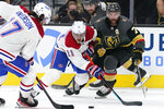Montreal Canadiens right wing Brendan Gallagher (11) vies for the puck with Vegas Golden Knights defenseman Alex Pietrangelo (7) during the third period in Game 1 of an NHL hockey Stanley Cup semifinal playoff series Monday, June 14, 2021, in Las Vegas. (AP Photo/John Locher)