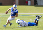 Presbyterian quarterback Ren Hefley (12) skirts the tackle of St. Andrews' Rashon Gholson (95) during a college football game, Saturday, Sept. 4, 2021, at Bailey Memorial Stadium in Clinton, S.C. (Sam Wolfe/The State via AP)