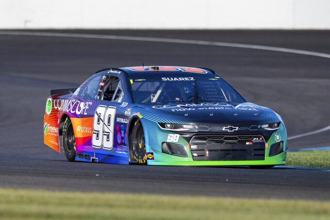Daniel Suarez (99) during qualifying for a NASCAR Cup Series auto race at Indianapolis Motor Speedway, Sunday, Aug. 15, 2021, in Indianapolis. (AP Photo/Doug McSchooler)