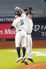 New York Yankees' Brett Gardner, left, celebrates with Gary Sanchez after they scored on a home run by Gardner during the fourth inning of a baseball game against the Toronto Blue Jays Thursday, Sept. 17, 2020, in New York. (AP Photo/Frank Franklin II)