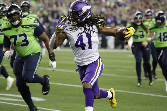 Minnesota Vikings' Anthony Harris (41) scores as he returns an interception against the Seattle Seahawks during the first half of an NFL football game, Monday, Dec. 2, 2019, in Seattle. (AP Photo/Ted S. Warren)