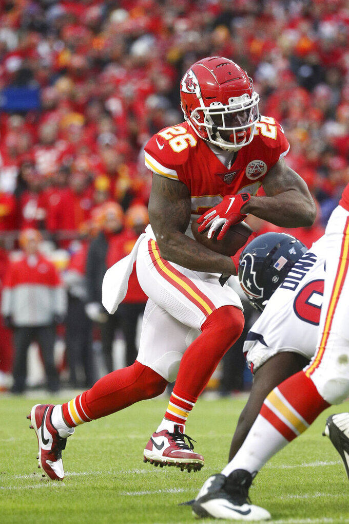 Kansas City Chiefs running back Damien Williams (26) carries the ball during an NFL divisional playoff game against the Houston Texans Sunday, Jan. 12, 2020 in Kansas City. The Chiefs defeated the Texans 51-31 (Margaret Bowles via AP)