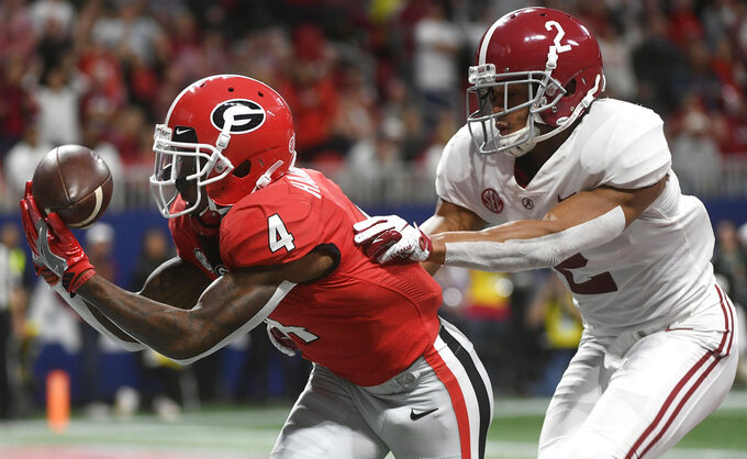 Georgia wide receiver Mecole Hardman (4) misses the catch in the end zone against Alabama defensive back Patrick Surtain II (2) during the first half of the Southeastern Conference championship NCAA college football game, Saturday, Dec. 1, 2018, in Atlanta. (AP Photo/John Amis)