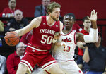 Indiana forward Joey Brunk (50) moves the ball as Rutgers forward Shaq Carter (13) defends during the first half of an NCAA college basketball game, Wednesday, Jan. 15, 2020 in Piscataway, N.J. (Andrew Mills/NJ Advance Media via AP)