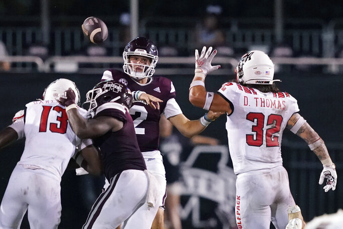 Mississippi State quarterback Will Rogers (2) is rushed into passing by North Carolina State linebacker Drake Thomas (32) during the second half of an NCAA college football game in Starkville, Miss., Saturday, Sept. 11, 2021. (AP Photo/Rogelio V. Solis)