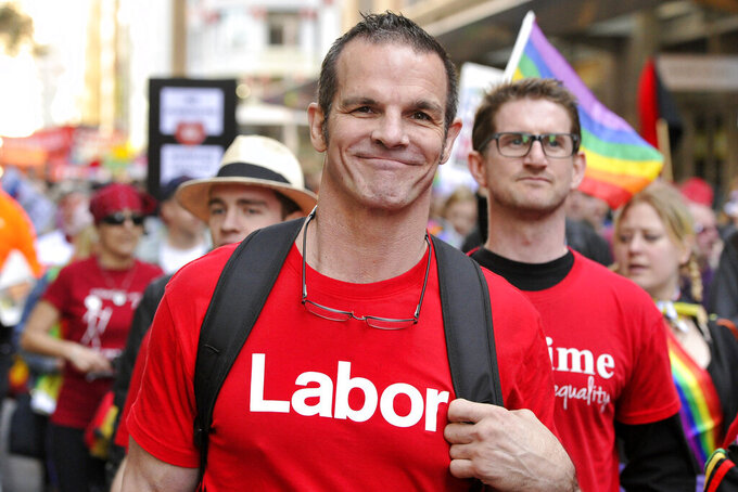 Labor Party candidate for Sydney City Council and former National Rugby League football player Ian Roberts marches in a marriage equality rally in Sydney, Aug. 13, 2016. In 1995 Roberts became the first high-profile Australian sportsperson to come out as gay. (Joel Carrett/AAP Image via AP)