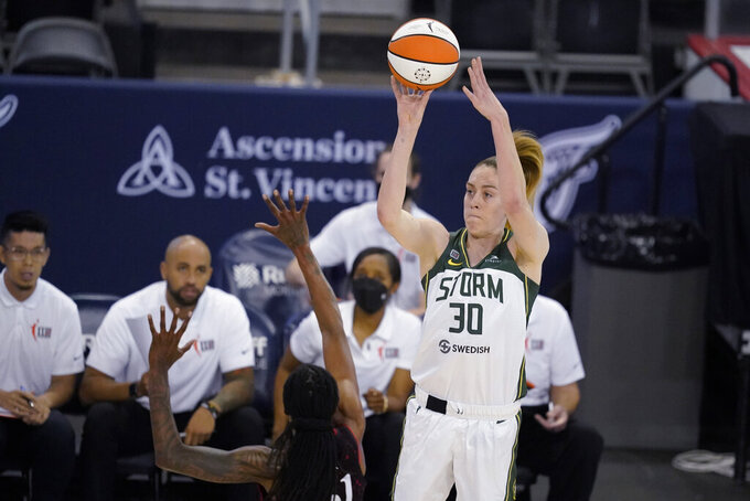 Seattle Storm's Breanna Stewart shoots over Indiana Fever's Jessica Breland during the second half of a WNBA basketball game Thursday, June 17, 2021, in Indianapolis. (AP Photo/Darron Cummings)