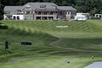 The clubhouse is visible during a practice round ahead of the Travelers Championship golf tournament at TPC River Highlands, Wednesday, June 24, 2020, in Cromwell, Conn. (AP Photo/Frank Franklin II)