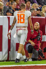 Tennessee quarterback Brian Maurer (18) walks off the field after being hurt during the first half of an NCAA college football game, Saturday, Oct. 19, 2019, in Tuscaloosa, Ala. (AP Photo/Vasha Hunt)