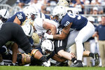 Penn State defensive end Yetur Gross-Matos (99) and linebacker Jan Johnson (36) tackle Idaho fullback Logan Kendall (32) in the first quarter of an NCAA college football game in State College, Pa., on Saturday, Aug. 31, 2019. (AP Photo/Barry Reeger)