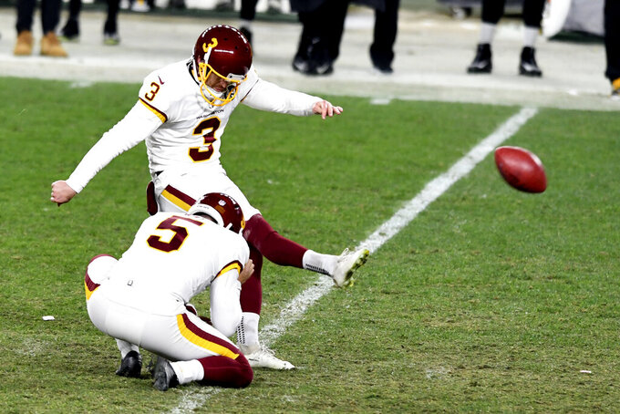 Washington Football Team kicker Dustin Hopkins (3) makes a 45-yard field goal during the second half of an NFL football game against the Pittsburgh Steelers in Pittsburgh, Monday, Dec. 7, 2020. (AP Photo/Barry Reeger)