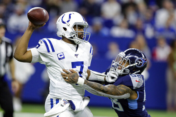 Indianapolis Colts quarterback Jacoby Brissett (7) throws an interception as he is hit by Tennessee Titans linebacker Harold Landry (58) during the second half of an NFL football game in Indianapolis, Sunday, Dec. 1, 2019. (AP Photo/Darron Cummings)