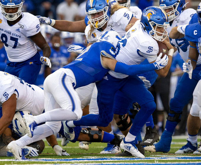San Jose State quarterback Nick Nash (16) runs the ball as Air Force defensive back Jeremy Fejedelem (2) brings him down during the first quarter of an NCAA college football game, Friday, Sept. 27, 2019, at Air Force Academy, Colo. (Christian Murdock/The Gazette via AP)
