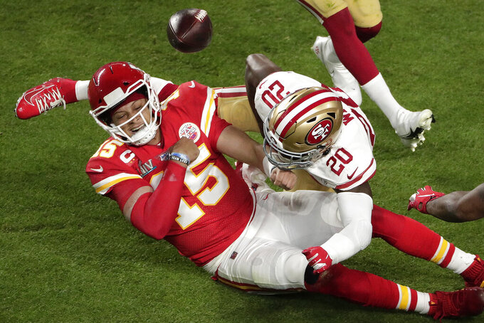 Kansas City Chiefs' Morris Claiborne (20) knocks the ball from the hands of Kansas City Chiefs quarterback Patrick Mahomes (15), during the first half of the NFL Super Bowl 54 football game, Sunday, Feb. 2, 2020, in Miami Gardens, Fla. (AP Photo/Charlie Riedel)