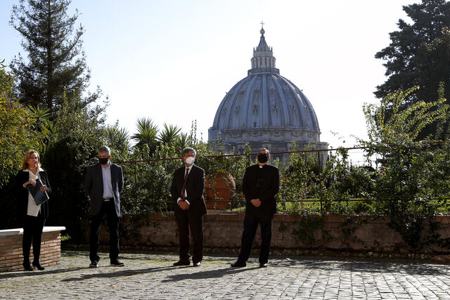 From left, Rosetta Sannelli, director of the Kineo Movie for Humanity Award, director Evgeny Afineevsky, Paolo Ruffini, prefect of the dicastery of Communication, and Monsignor Ruiz, secretary of the dicastery, pose for a photo respecting the social distancing during the award ceremony at the Vatican, Thursday, Oct. 22, 2020. Director Evgeny Afineevsky was awarded with Kineo prize Thursday for the movie