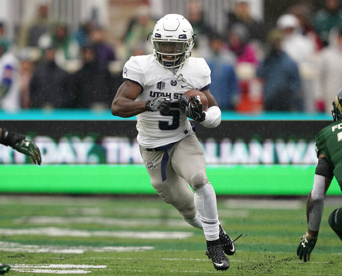 Utah State running back Darwin Thompson runs against Colorado State during the first half of an NCAA football game Saturday, Nov. 17, 2018, in Fort Collins, Colo. (AP Photo/Jack Dempsey)