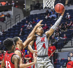 Mississippi guard Breein Tyree (4) scores against Seattle guard Morgan Means, left, and forward Myles Carter during an NCAA college basketball game Tuesday, Nov. 19, 2019, in Oxford, Miss. (Bruce Newman/The Oxford Eagle via AP)