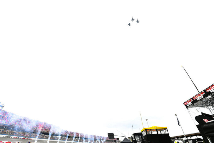 F-18 Super Hornet jets fly over Talladega Superspeedway before a NASCAR Cup series auto race Sunday, Oct. 3, 2021, in Talladega, Ala. (AP Photo/John Amis)