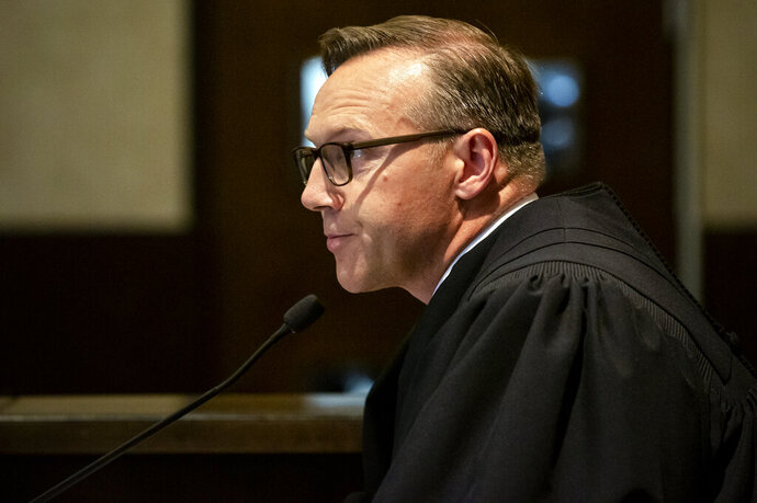 Judge Thad Balkman reads a summary of his decision in the opioid trial at the Cleveland County Courthouse in Norman, Okla., Monday, Aug. 26, 2019. Balkman ruled in favor of the state of Oklahoma and ordered Johnson and Johnson to pay $572 million to a plan to abate the opioid crisis. (Chris Landsberger/The Oklahoman via AP, Pool)
